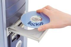 Débordement sur disque de main et d'ordinateur Photos stock