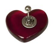 Décalage de bâton sur le coeur rouge Photos stock