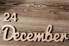 24 décembre Fond de réveillon de Noël avec l'espace vide 24ème jour du mois dernier par année filtre de vintage Image libre de droits