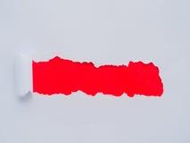Déchirement d'un trou de cadre de livre blanc Photo stock
