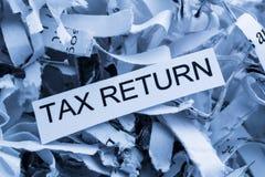 Déclaration d'impôt de papier déchiquetée Image libre de droits