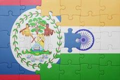 Déconcertez avec le drapeau national de Belize et d'Inde Image libre de droits