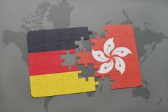 déconcertez avec le drapeau national de l'Allemagne et de Hong Kong sur un fond de carte du monde Photographie stock libre de droits