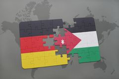 déconcertez avec le drapeau national de l'Allemagne et de la Jordanie sur un fond de carte du monde Images libres de droits