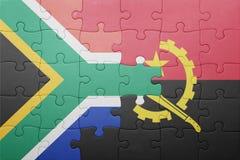 déconcertez avec le drapeau national de l'Angola et de l'Afrique du Sud Illustration Stock