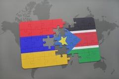 déconcertez avec le drapeau national de l'Arménie et des sud Soudan sur une carte du monde Image stock