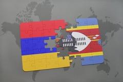 déconcertez avec le drapeau national de l'Arménie et du Souaziland sur une carte du monde Image libre de droits