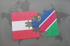déconcertez avec le drapeau national de l'Autriche et de la Namibie sur un fond de carte du monde Photo stock