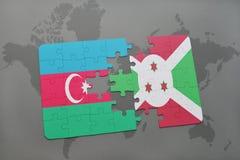 déconcertez avec le drapeau national de l'Azerbaïdjan et du Burundi sur une carte du monde Photographie stock libre de droits