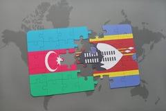 déconcertez avec le drapeau national de l'Azerbaïdjan et du Souaziland sur une carte du monde Image libre de droits
