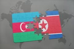 déconcertez avec le drapeau national de l'Azerbaïdjan et de la Corée du Nord sur une carte du monde Image libre de droits