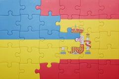 Déconcertez avec le drapeau national de l'Espagne et de l'Ukraine Photographie stock