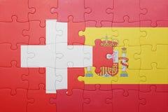 Déconcertez avec le drapeau national de l'Espagne et de la Suisse Image stock