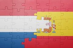 Déconcertez avec le drapeau national de l'Espagne et des Hollandes Image stock