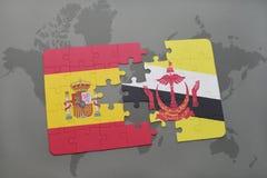 déconcertez avec le drapeau national de l'Espagne et du Brunei sur un fond de carte du monde Photos libres de droits