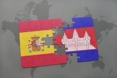 déconcertez avec le drapeau national de l'Espagne et du Cambodge sur un fond de carte du monde Images libres de droits