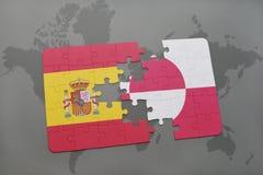 déconcertez avec le drapeau national de l'Espagne et du Groenland sur un fond de carte du monde Photo libre de droits