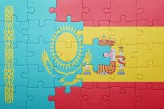 Déconcertez avec le drapeau national de l'Espagne et du Kazakhstan Image libre de droits