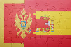 Déconcertez avec le drapeau national de l'Espagne et du Monténégro Photos libres de droits
