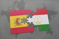 déconcertez avec le drapeau national de l'Espagne et du Tadjikistan sur un fond de carte du monde Photographie stock
