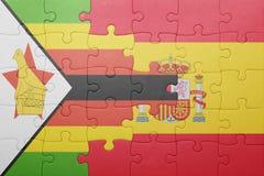 déconcertez avec le drapeau national de l'Espagne et du Zimbabwe Images libres de droits