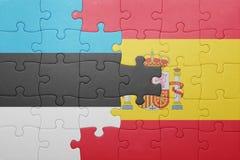 Déconcertez avec le drapeau national de l'Espagne et de l'Estonie Image libre de droits