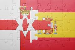 Déconcertez avec le drapeau national de l'Espagne et de l'Irlande du Nord Photos libres de droits
