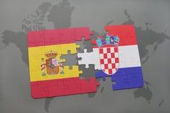 déconcertez avec le drapeau national de l'Espagne et de la Croatie sur un fond de carte du monde Image libre de droits