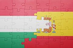 Déconcertez avec le drapeau national de l'Espagne et de la Hongrie Image libre de droits
