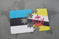 déconcertez avec le drapeau national de l'Estonie et du Brunei sur une carte du monde Image libre de droits