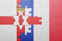 Déconcertez avec le drapeau national de l'Irlande du Nord et des Frances Photos libres de droits