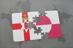 déconcertez avec le drapeau national de l'Irlande du Nord et du Groenland sur une carte du monde Photographie stock libre de droits