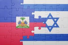 Déconcertez avec le drapeau national de l'Israël et du Haïti Photos libres de droits
