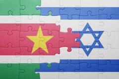 Déconcertez avec le drapeau national de l'Israël et du Surinam Photographie stock libre de droits
