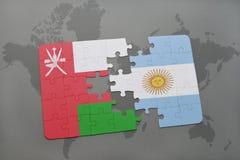 déconcertez avec le drapeau national de l'Oman et de l'Argentine sur un fond de carte du monde Photos libres de droits