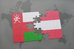 déconcertez avec le drapeau national de l'Oman et de l'Autriche sur un fond de carte du monde Image libre de droits