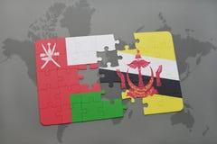 déconcertez avec le drapeau national de l'Oman et du Brunei sur un fond de carte du monde Photos libres de droits