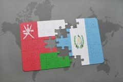 déconcertez avec le drapeau national de l'Oman et du Guatemala sur un fond de carte du monde Photographie stock libre de droits