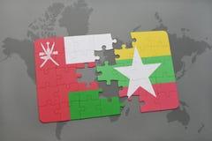 déconcertez avec le drapeau national de l'Oman et du myanmar sur un fond de carte du monde Photo libre de droits