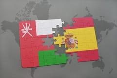 déconcertez avec le drapeau national de l'Oman et de l'Espagne sur un fond de carte du monde Photographie stock