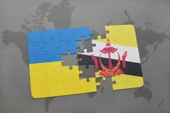 déconcertez avec le drapeau national de l'Ukraine et du Brunei sur une carte du monde Photos stock