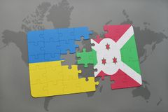 déconcertez avec le drapeau national de l'Ukraine et du Burundi sur une carte du monde Images stock
