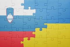 déconcertez avec le drapeau national de l'Ukraine et de la Slovénie Photographie stock