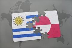 déconcertez avec le drapeau national de l'Uruguay et du Groenland sur un fond de carte du monde Photos libres de droits
