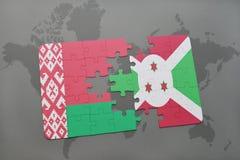 déconcertez avec le drapeau national de la Biélorussie et du Burundi sur une carte du monde Images stock