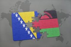 déconcertez avec le drapeau national de la Bosnie-Herzégovine et du Malawi sur une carte du monde Photographie stock