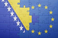 Déconcertez avec le drapeau national de la Bosnie-Herzégovine et de l'Union européenne Photo libre de droits