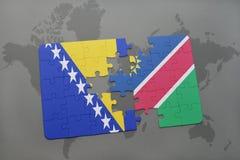 déconcertez avec le drapeau national de la Bosnie-Herzégovine et de la Namibie sur une carte du monde Images stock