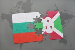 déconcertez avec le drapeau national de la Bulgarie et du Burundi sur une carte du monde Images stock