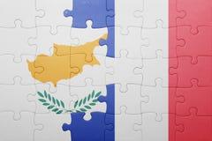 Déconcertez avec le drapeau national de la Chypre et des Frances Photographie stock